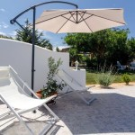 15 SÍTIO DAS ROLAS - Swimming pool terrace and lawn (BBQ area behind the trees)