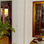 2.13 CASA PAVÃO - View through the bedroom door to terrace door during sunset